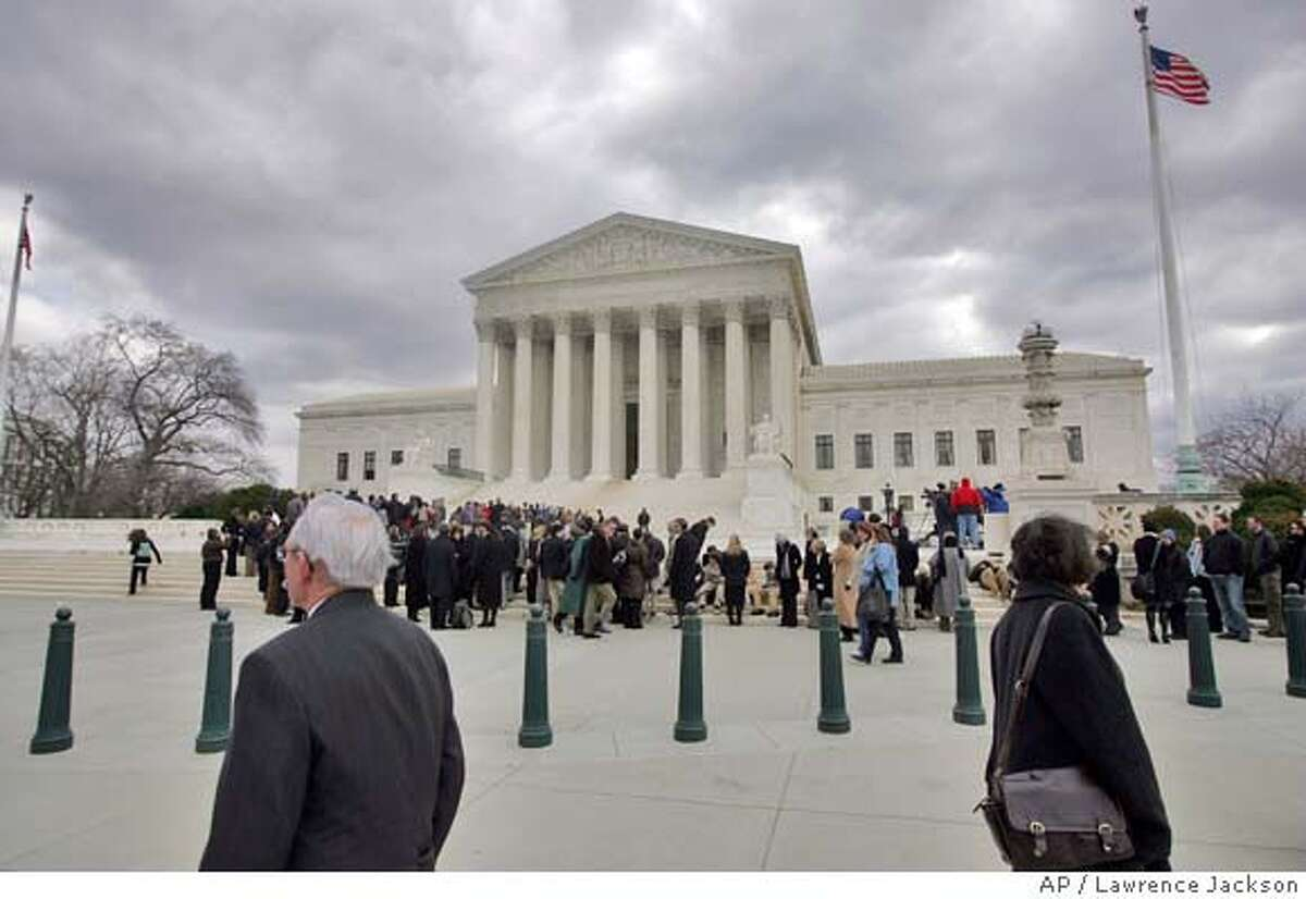 A line forms outside the Supreme Court in Washington, Wednesday, Feb. 27, 2008, prior to the court's Exxon Valdez case. The justices heard arguments to consider Exxon Mobil's bid to overturn, or at least reduce, the $2.5 billion punitive-damage award for the Prince William Sound tanker spill, the largest in U.S. history.(AP Photo/Lawrence Jackson)