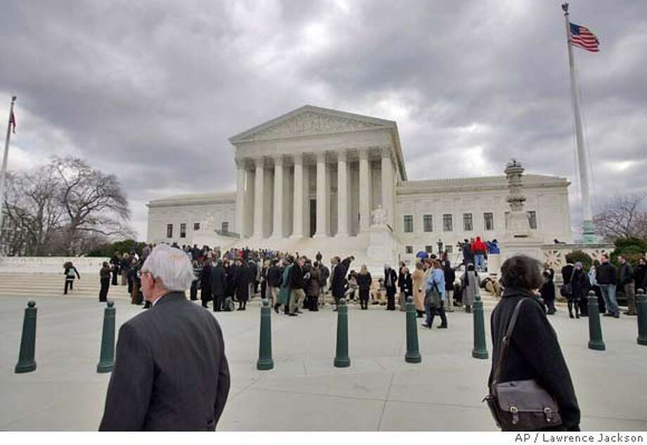 A line forms outside the Supreme Court in Washington, Wednesday, Feb. 27, 2008, prior to the court's Exxon Valdez case. The justices heard arguments to consider Exxon Mobil's bid to overturn, or at least reduce, the $2.5 billion punitive-damage award for the Prince William Sound tanker spill, the largest in U.S. history.(AP Photo/Lawrence Jackson) Photo: Lawrence Jackson