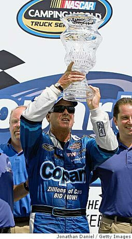 WEST ALLIS, WI - JUNE 20:  Ron Hornaday Jr., driver of the #33 Copart Chevrolet, holds the trophy after winning  the NASCAR Camping World Truck Series Copart 200 on June 20, 2009 at the Milwaukee Mile in West Allis, Wisconsin. (Photo by Jonathan Daniel/Getty Images) Photo: Jonathan Daniel, Getty Images