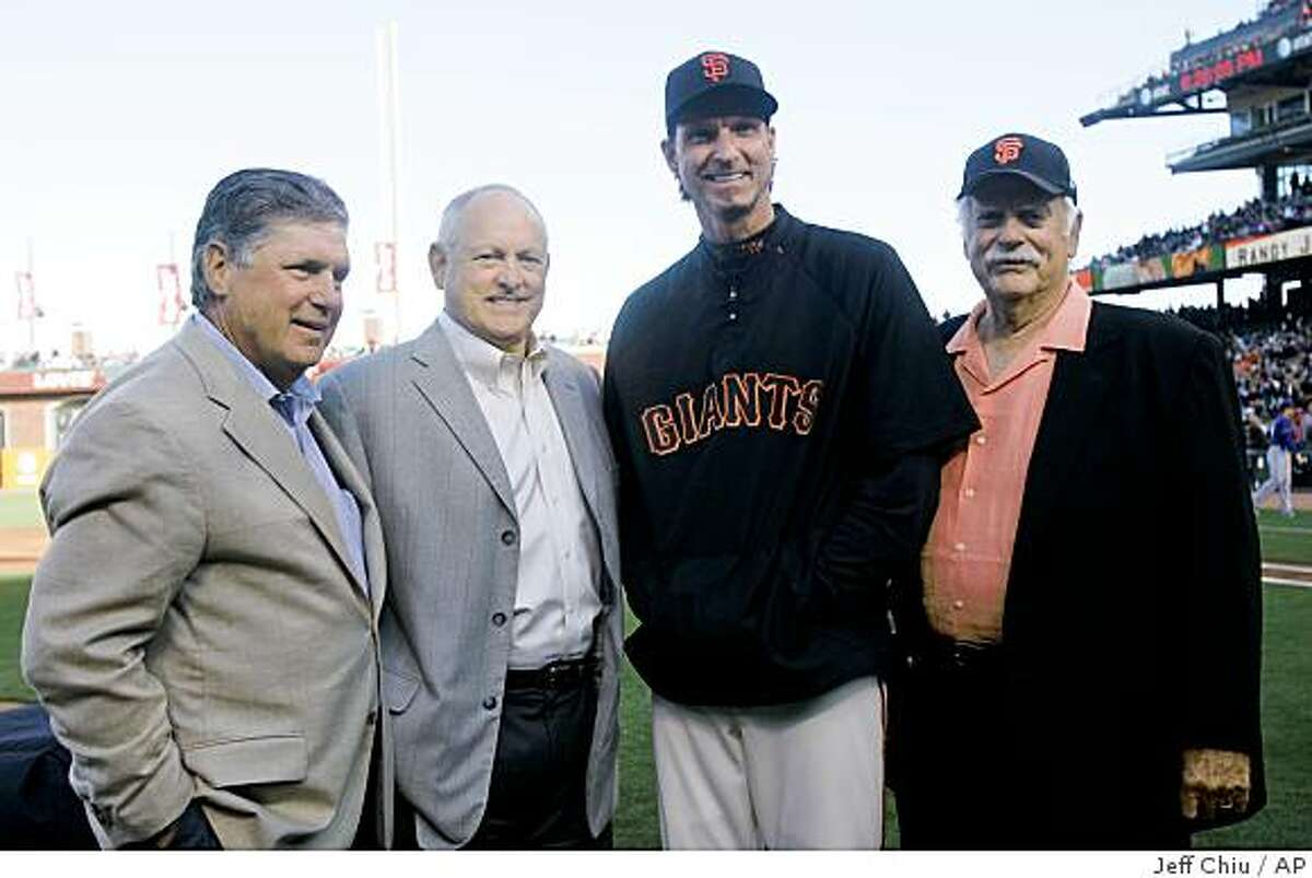 San Francisco Giants' Randy Johnson, second from right, poses for a photo with Hall of Fame pitchers Tom Seaver, from left, Nolan Ryan, and Gaylord Perry at a ceremony celebrating Johnson's 300th victory before the Giants play the Texas Rangers in a baseball game in San Francisco, Saturday, June 20, 2009. (AP Photo/Jeff Chiu)