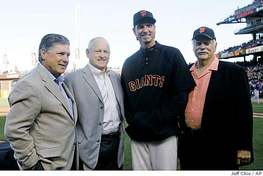 San Francisco Giants' Randy Johnson, second from right, poses for a photo with Hall of Fame pitchers Tom Seaver, from left, Nolan Ryan, and Gaylord Perry at a ceremony celebrating Johnson's 300th victory before the Giants play the Texas Rangers in a baseball game in San Francisco, Saturday, June 20, 2009. (AP Photo/Jeff Chiu) Photo: Jeff Chiu, AP