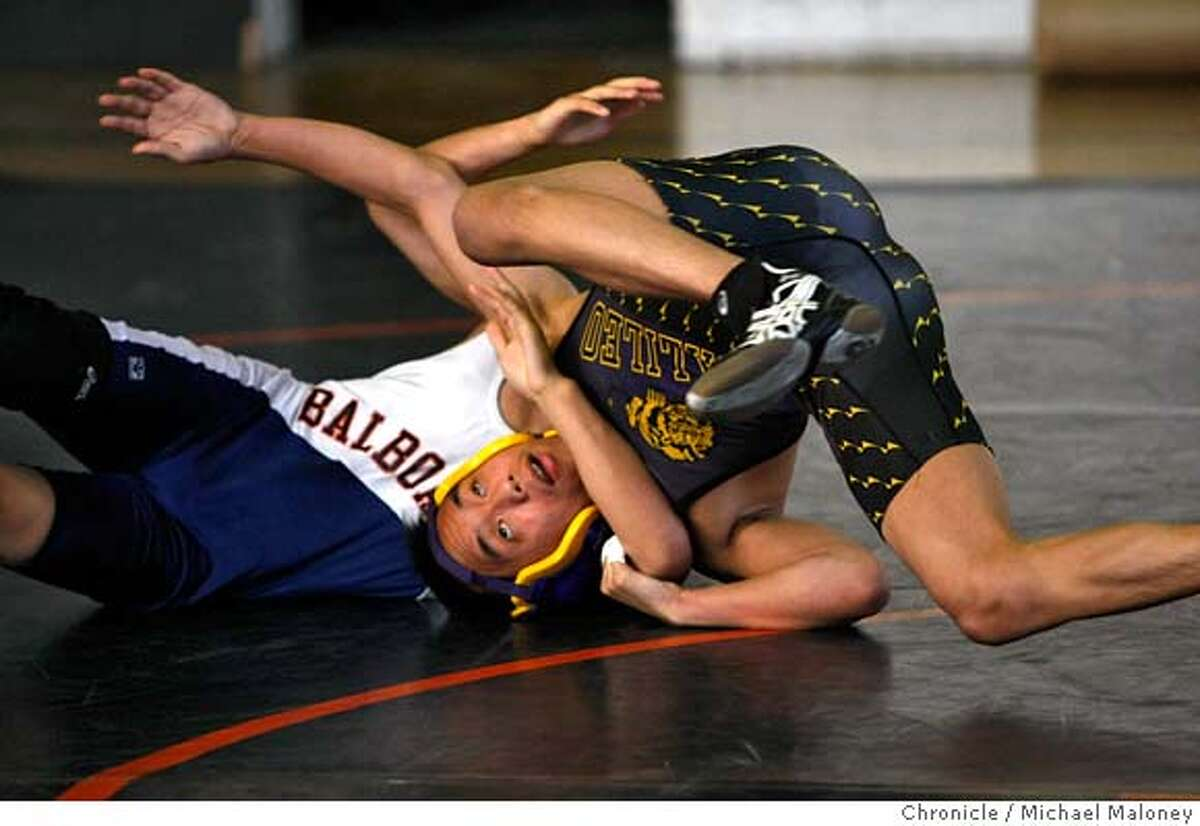 Galileo High wrestler Sam Chue (right) escapes from Balboa's Mitchell Marcaida. Balboa high school hosts Galileo in a boys wrestling match on February 13, 2008 in San Francisco, CA. Photo by Michael Maloney / The Chronicle MANDATORY CREDIT FOR PHOTOG AND SAN FRANCISCO CHRONICLE/NO SALES-MAGS OUT