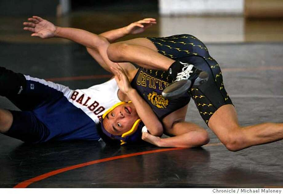Galileo High wrestler Sam Chue (right) escapes from Balboa's Mitchell Marcaida.  Balboa high school hosts Galileo in a boys wrestling match on February 13, 2008 in San Francisco, CA.  Photo by Michael Maloney / The Chronicle MANDATORY CREDIT FOR PHOTOG AND SAN FRANCISCO CHRONICLE/NO SALES-MAGS OUT Photo: Michael Maloney