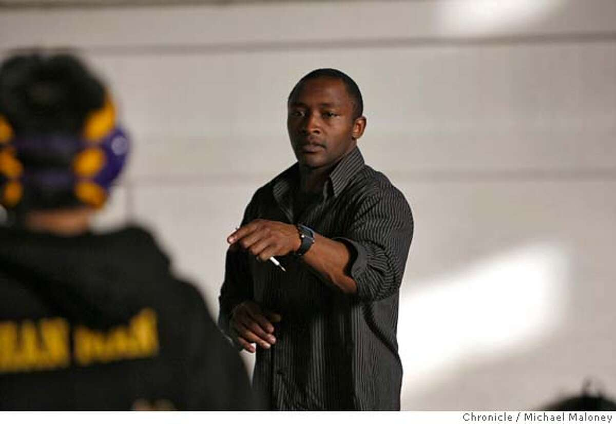 Galileo High coach Terence Carter talks to his wrestlers prior to a match against host Balboa high school on February 13, 2008 in San Francisco, CA. Photo by Michael Maloney / The Chronicle MANDATORY CREDIT FOR PHOTOG AND SAN FRANCISCO CHRONICLE/NO SALES-MAGS OUT