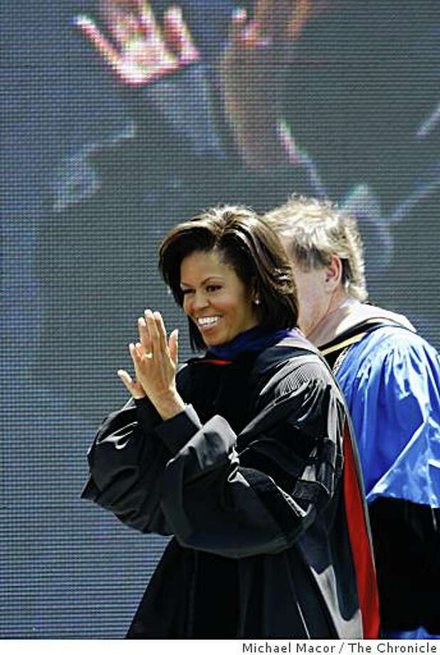 First Lady Michelle Obama, claps to the graduatuing upon entering the stage, moments before she  delivers the commencement speech to the first full graduating class of UC Merced on Saturday, May 16, 2009 in Merced, Calif. Photo: Michael Macor, The Chronicle