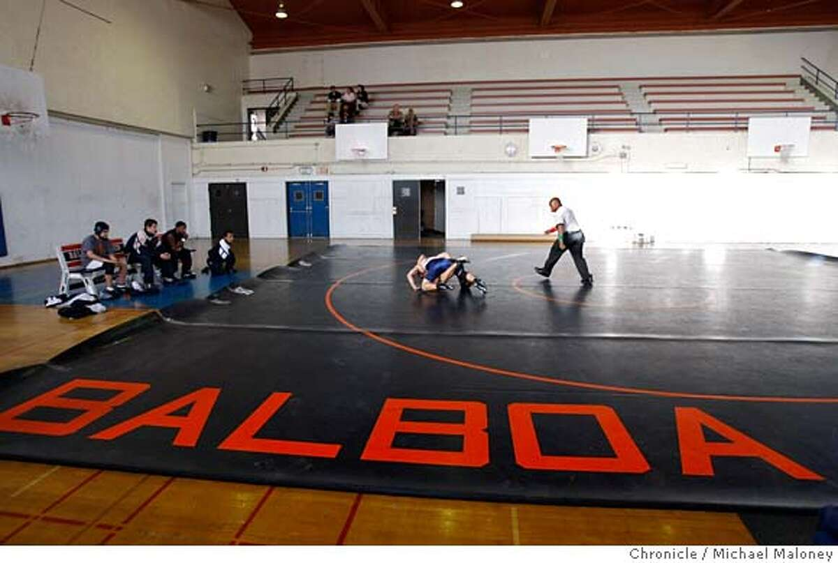 With just a handful of spectators looking on, including the Balboa bench at left, Balboa's Mitchell Marcaida takes on Galileo's Rihthy Chan as referee Marcel Thomas officiates. There are only 5 wrestlers on the Balboa team. Balboa high school hosts Galileo in a boys wrestling match on February 13, 2008 in San Francisco, CA. Photo by Michael Maloney / The Chronicle MANDATORY CREDIT FOR PHOTOG AND SAN FRANCISCO CHRONICLE/NO SALES-MAGS OUT
