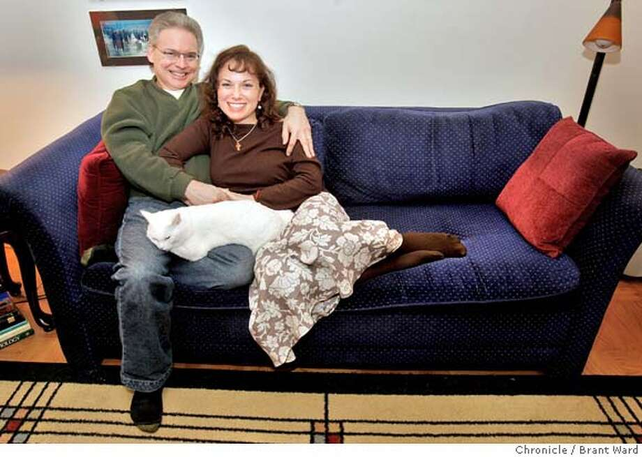 Robin, left, and Wendy McLeod relax at their San Francisco home with their cat Pearl.  {By Brant Ward/San Francisco Chronicle}  Ran on: 02-24-2008 Photo: Brant Ward
