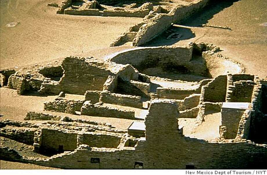 Chaco Canyon National Historic Park in northwestern New Mexico near Farmington, is shown in this undated file  photo provided by the New Mexico Department of Tourism. Remains of macaws and parrots, copper bells and seashells have been found in  the canyon, evidence of trade that flourished between 1020 and 1120.  (New Mexico Department of Tourism via The New York Tiems) Photo: New Mexico Dept Of Tourism, NYT