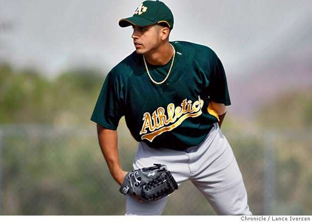 Oakland Athletics pitcher #76 Gio Gonzalez waits for the sign during batting practice Wednesday at Papago Park, home of the Oakland Athletics during spring training while in Phoenix. By Lance Iversen/The San Francisco Chronicle MANDATORY CREDIT PHOTOG AND SAN FRANCISCO CHRONICLE/NO SALES MAGS OUT Photo: Lance Iversen