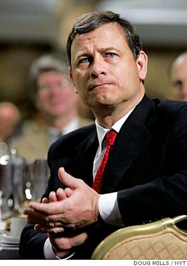 **FILE PHOTO** Chief Justice John Roberts Jr. applauds President George W. Bush during the National Catholic Prayer Breakfast in Washington in this April 7, 2006 file photo. Roberts emerged as a canny strategist at the Supreme Court this term, laying the groundwork for bold changes that could take the court to the right even as the recent elections moved the nation to the left. (Doug Mills/The New York Times) Photo: DOUG MILLS, NYT