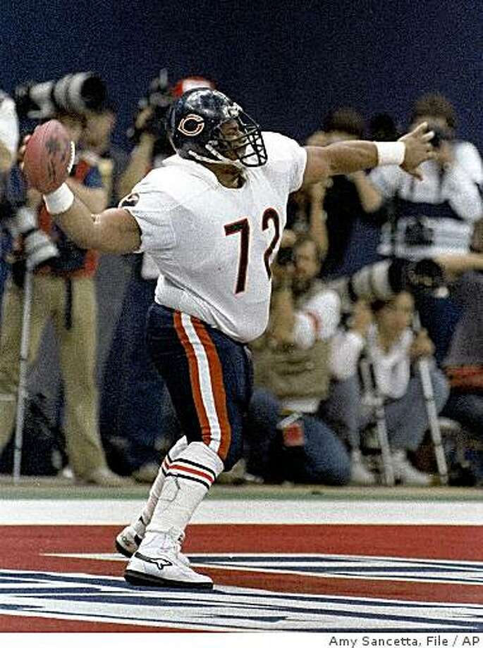 "-- FILE -- In this Jan. 26, 1986, file photo, Chicago Bears' William ""The Refrigerator"" Perry spikes the ball after scoring a touchdown in Super Bowl XX in New Orleans, La. Perry spent more than a month at Aiken Regional Medical Center this spring, suffering from Guillain-Barre syndrome, a disease where the body's immune system attacks its peripheral nerves. (AP Photo/Amy Sancetta,file) Photo: Amy Sancetta, File, AP"