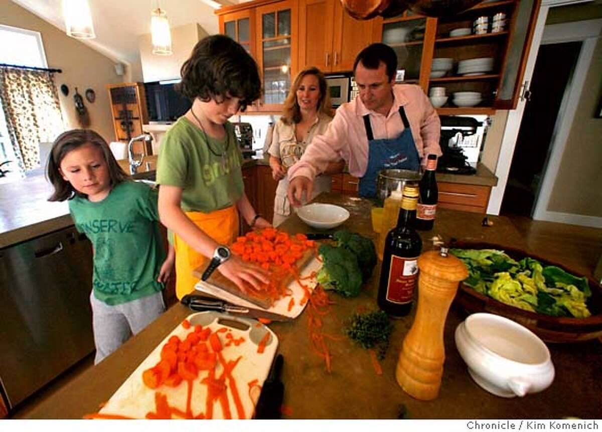 Piperade Chef Gerald Hirigoyen (right) has a Chef's Night In at home with his family on February 20, 2008 in Mill Valley. L to R, Bix, 10, Mickey, 8, Cameron and Gerald Hirigoyen Photo by Kim Komenich/San Francisco Chronicle MANDATORY CREDIT FOR PHOTOG AND SAN FRANCISCO CHRONICLE. NO SALES- MAGS OUT.