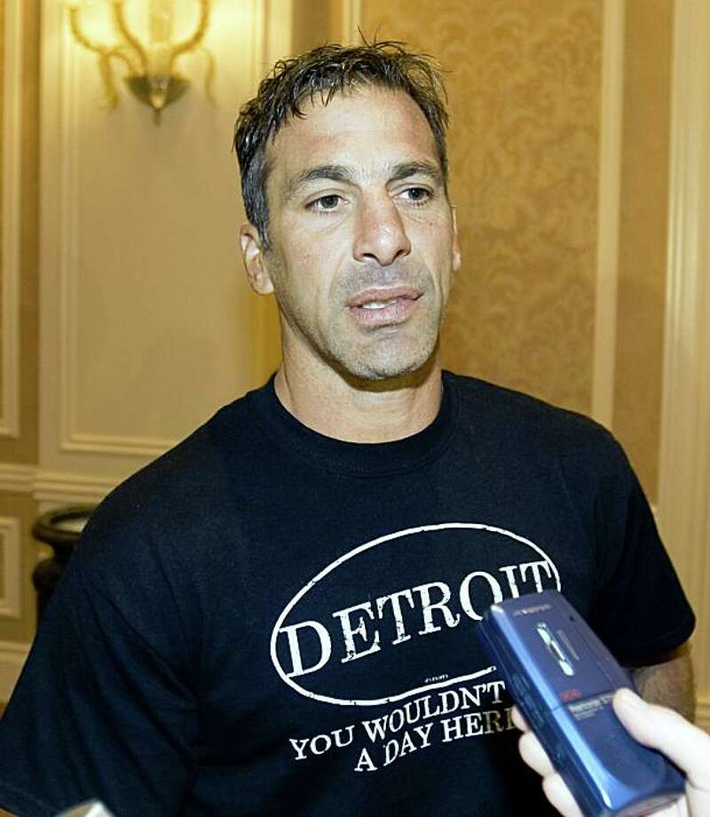 FILE - In this Friday, June 19, 2009, file photo, Detroit Red Wings' Chris Chelios speaks to reporters during a break at the NHL Players Association meetings in Las Vegas. Chelios won't be in a Red Wings uniform next season. Wings general manager Ken Holland tells The Detroit News and the Detroit Free Press he met with the 47-year-old and told him he wouldn't be offered another contract. (AP Photo/The Canadian Press, Ryan Remiorz, File) Photo: Ryan Remiorz, AP