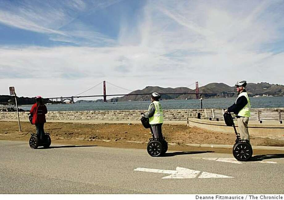 Tourists ride Segways along Crissy Field as part of Segway Tours on a warm afternoon at Crissy Field beach in San Francisco, Calif. on Tuesday, Feb. 26, 2008.Photo by Deanne Fitzmaurice / San Francisco Chronicle Photo: Deanne Fitzmaurice, The Chronicle
