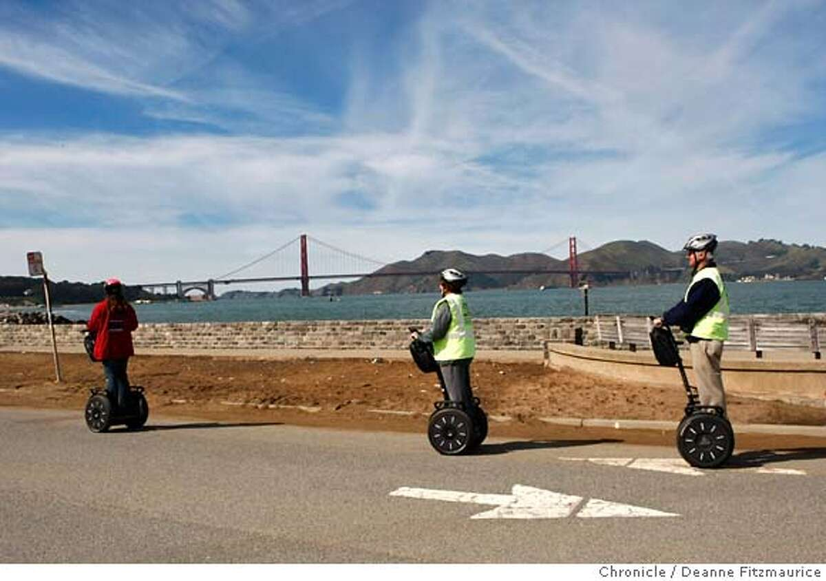 Tourists ride Segways along Crissy Field as part of Segway Tours on a warm afternoon at Crissy Field beach in San Francisco, Calif. on Tuesday, Feb. 26, 2008. Photo by Deanne Fitzmaurice / San Francisco Chronicle Mandatory credit for photographer and San Francisco Chronicle. No Sales/Magazines out.