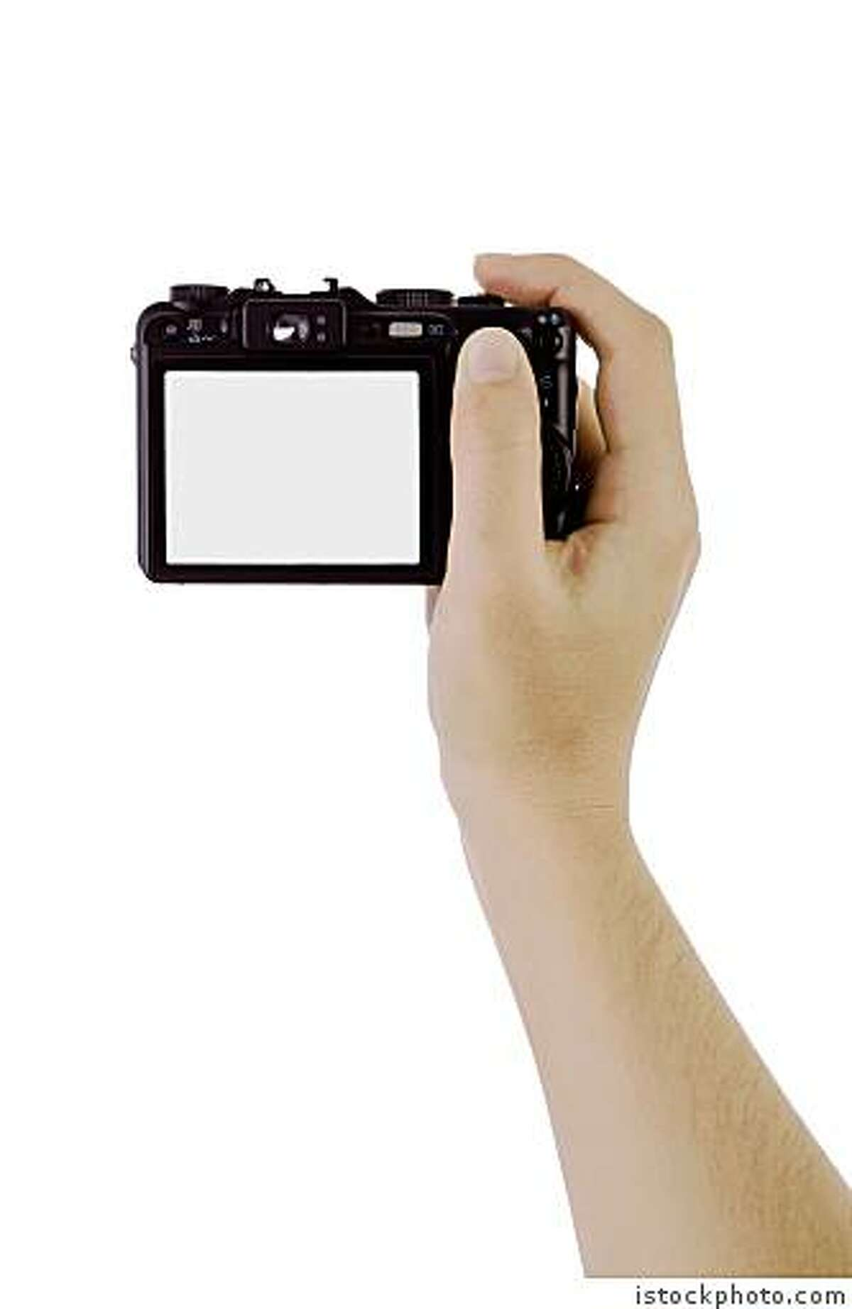 arm holding a digital cameraHand photographic with a digital camera isolated on white