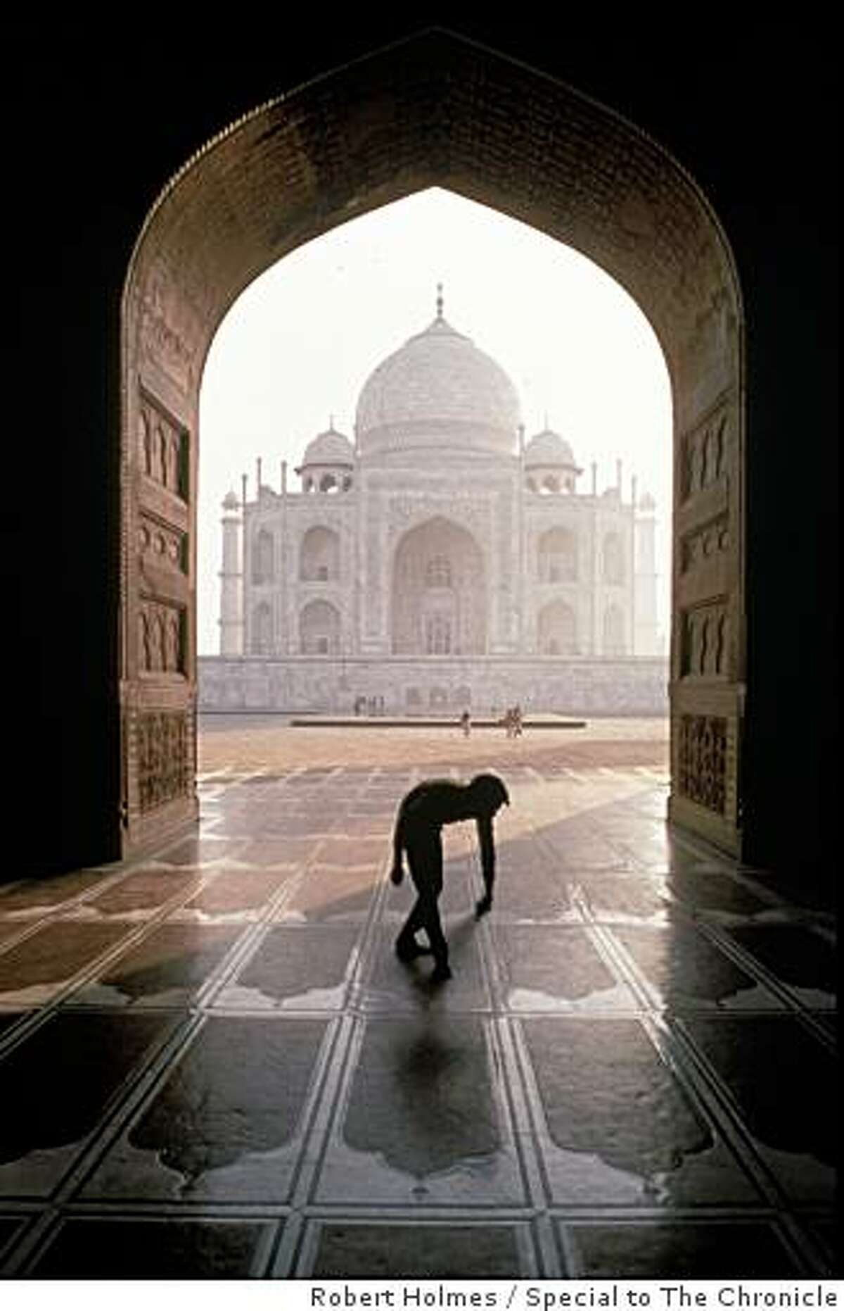 Taj Mahal, Agra. I knew the shot I wanted and had to wait until I had the right configuration of people. I saw this sweeper moving towards me and I knew this was the shot.