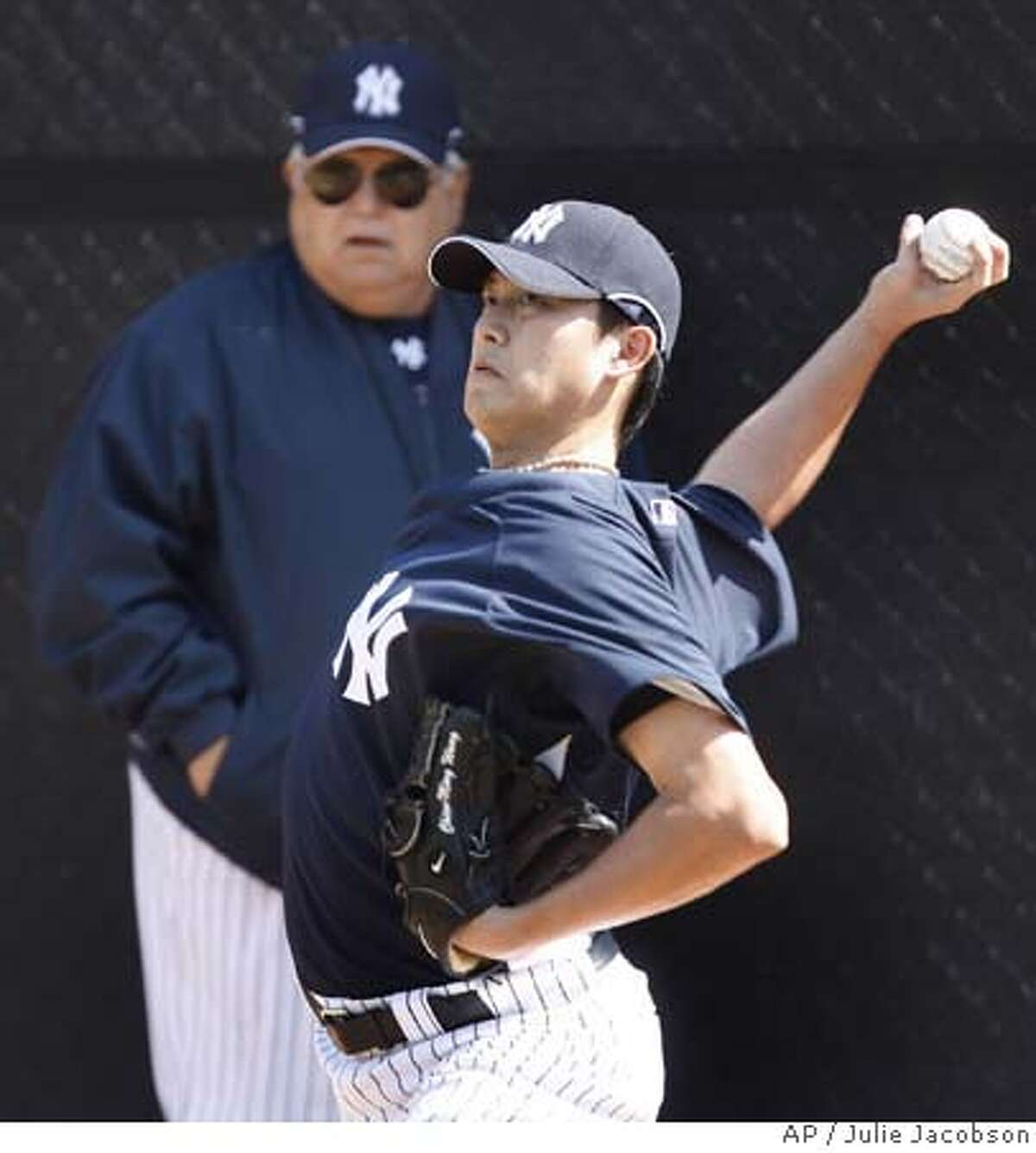 New York Yankees pitcher Chien-Ming Wang, right, throws in the bullpen as Yankees vice president Billy Connors looks on during the first day of spring training workouts Friday, Feb. 15, 2008 at Legends Field in Tampa, Fla. (AP Photo/Julie Jacobson) EFE OUT