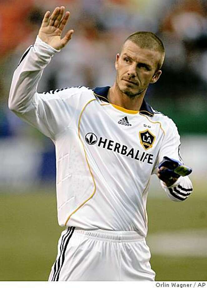 AC Milan is close to signing David Beckham in a loan deal that would allow the Los Angeles Galaxy midfielder and former England captain to play in Italy's Serie A for a few months starting in January. Photo: Orlin Wagner, AP