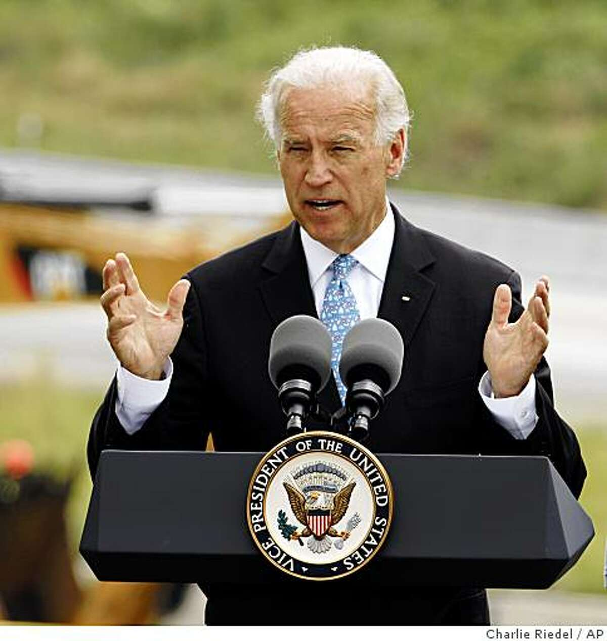Vice President Joe Biden talks about the stimulus program after touring a project to rebuild part of U.S. 69 Thursday, June 11, 2009, in Overland Park, Kan. The trip is part of a two-day swing highlighting construction projects undertaken with the help of federal recovery funds. (AP Photo/Charlie Riedel)