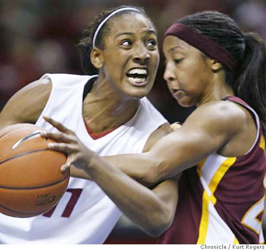 Candice Wiggins drives toward the basket and past Briann January . in the second half of action Stanford Beat AZ 62-55  2007 PAC-10 Women's Basketball Tournament at HP Pavilion Game 9 No.1 Stanford Vs No 2 Arizona State  MONDAY, MARCH 05, 2007 KURT ROGERS/THE CHRONICLE SAN JOSE THE CHRONICLE  SFC PAC10WOMEN06_0479_kr.jpg MANDATORY CREDIT FOR PHOTOG AND SF CHRONICLE / NO SALES-MAGS OUT Photo: KURT ROGERS/THE CHRONICLE