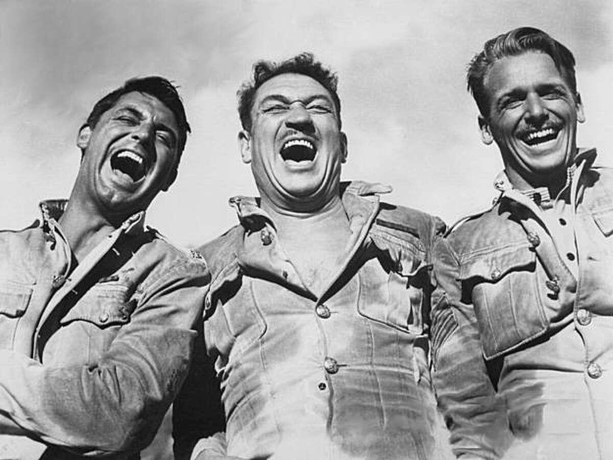 Cary Grant (left), Victor McLaglen and Douglas Fairbanks Jr. in