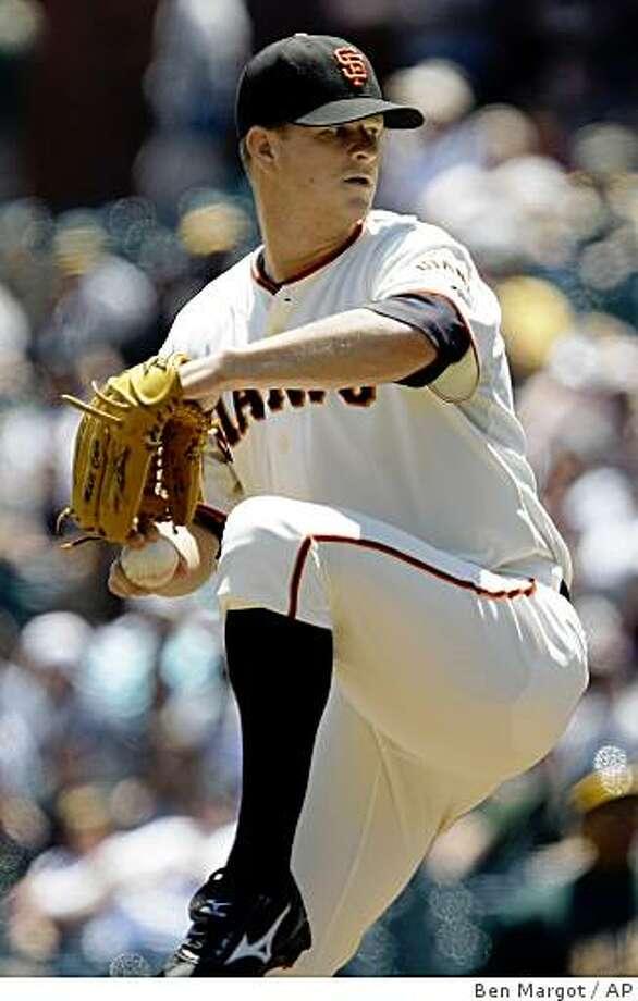 San Francisco Giants' Matt Cain works against the Oakland Athletics during the first inning of a baseball game Sunday, June 14, 2009, in San Francisco. (AP Photo/Ben Margot) Photo: Ben Margot, AP