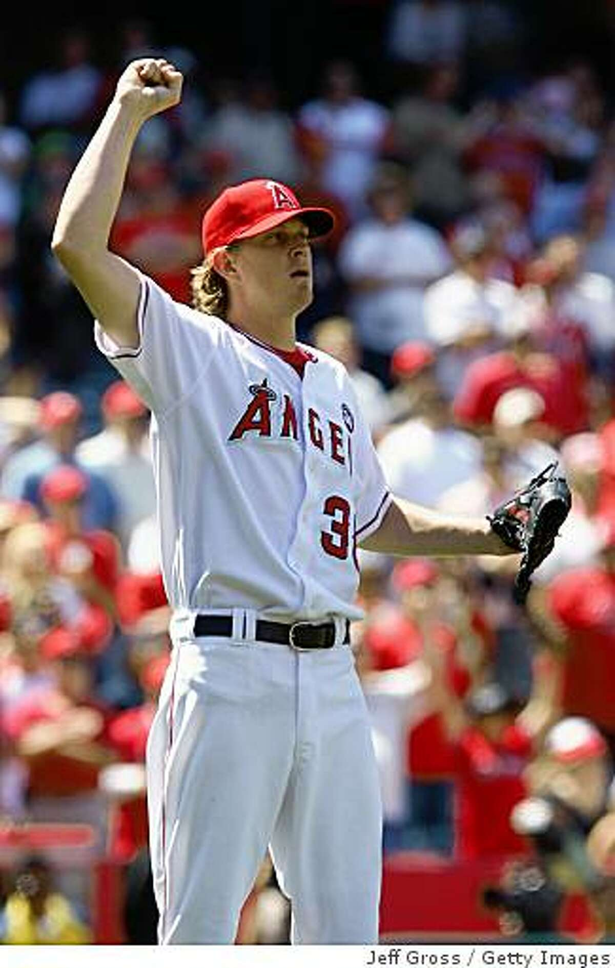 ANAHEIM, CA - JUNE 14: Pitcher Jered Weaver #36 of the Los Angeles Angels of Anaheim reacts after pitching a complete game shut-out against the San Diego Padres at Angel Stadium on June 14, 2009 in Anaheim, California. The Angels defeated the Padres 6-0. (Photo by Jeff Gross/Getty Images)