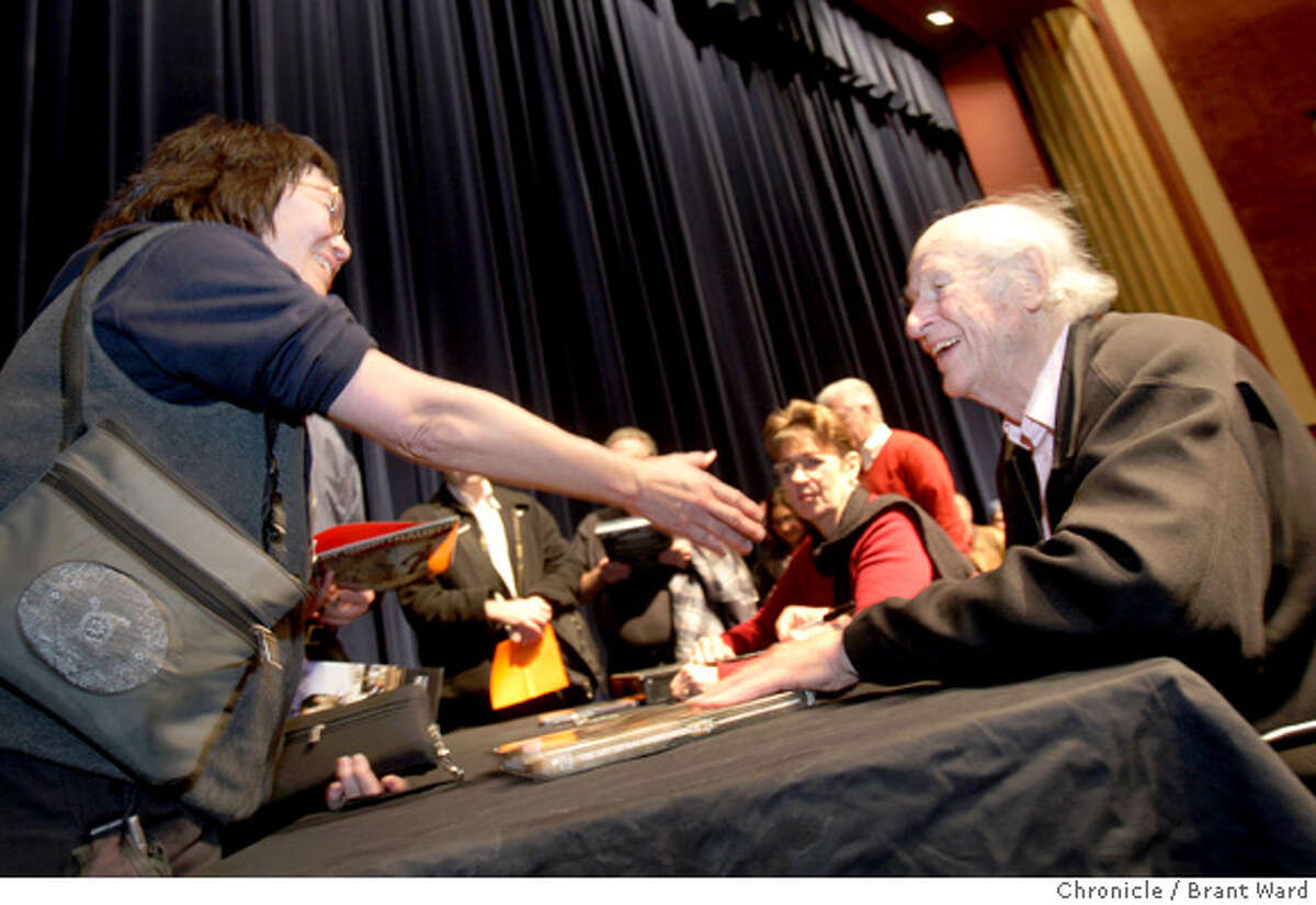 Joanne Wong, a huge Ray Harryhausen fan, reaches out to shake the hand of her idol. Harryhausen appeared with other special effects innovators at the Rafael Film Center in San Rafael.(2/20/2008) (Photo by Brant Ward/San Francisco Chronicle)