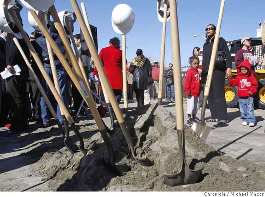 Karen Lewis, brought Mia Gillis, 4 and Sanjay Sanford, 3 to visit the groundbreaking ceremony today. They are from the Cupids Christian Day Care nearby and are looking forward to visits to the new library. Photo By Michael Macor//San Francisco Chronicle Photographed in, San Francisco, Ca, on 2/15/08 Mandatory credit for Photographer and San Francisco Chronicle No sales/ Magazines Out Photo: Michael Macor