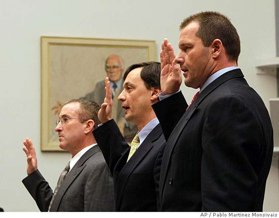 Former New York Yankees baseball pitcher Roger Clemens, right, lawyer Charles Scheeler center, and his former personal trainer Brian McNamee, are sworn-in before testify on Capitol Hill in Washington, Wednesday, Feb. 13, 2008, before the House Oversight, and Government Reform committee hearing on drug use in baseball. (AP Photo/Pablo Martinez Monsivais) Photo: Pablo Martinez Monsivais