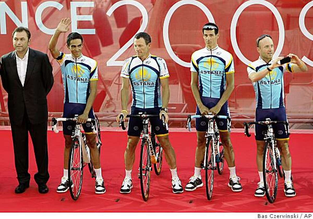 The Astana cycling team with team director Johan Bruyneel of Belgium, Alberto Contador of Spain, waving, American Lance Armstrong, Andreas Kloden of Germany, and American Levi Leipheimer, taking a picture, from left to right, are seen during the offical presentation of cycling teams in Monaco Thursday July 2, 2009, ahead of the start of the 96th edition of the Tour de France cycling race Saturday July 4, 2009. (AP Photo/Bas Czerwinski)