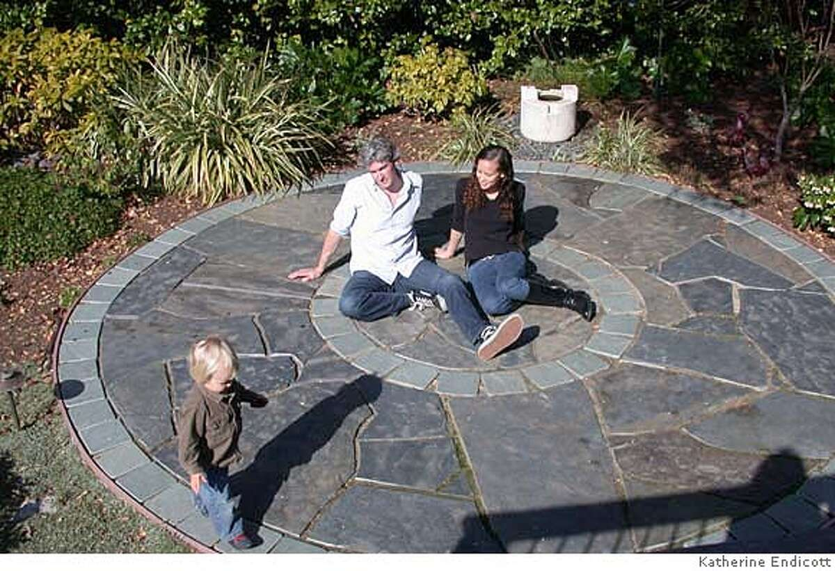 Christian Ehrhorn and Joy Lung with their son in a client's garden. Credit: Katherine Endicott