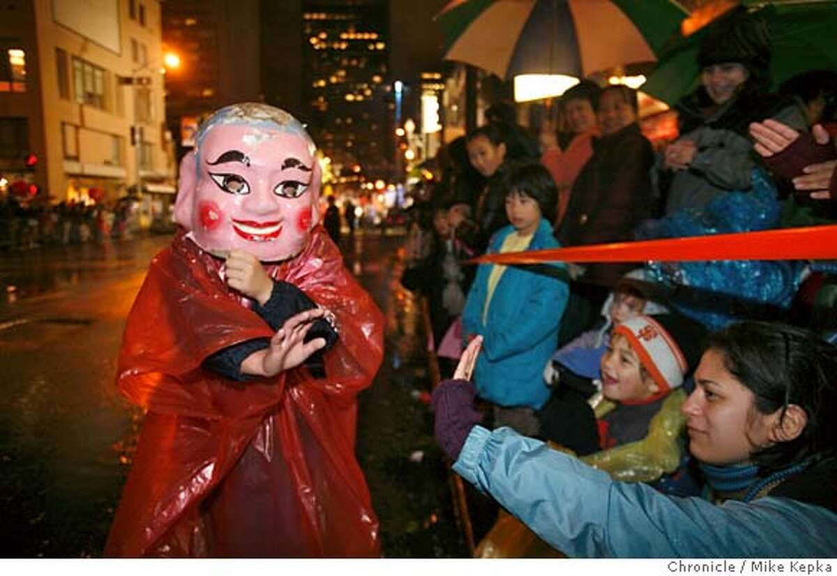 Wearing a Buddha mask, Paul Luu, 10, of San Francisco waves to watchers during the Chinese New Year on Saturday, Feb. 23, 2008 in San Francisco, Calif. Photo by Mike Kepka / San Francisco Chronicle