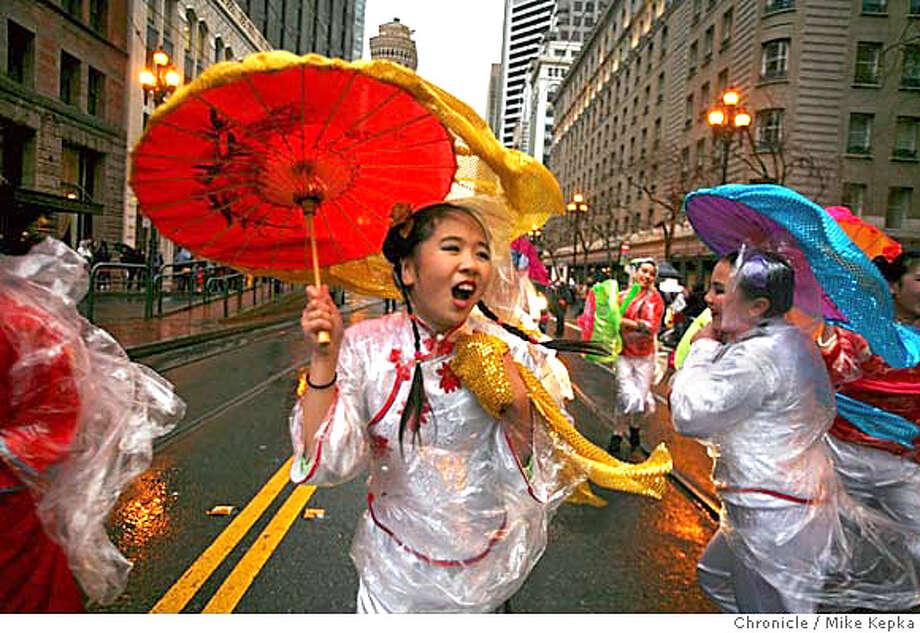 Bonnie Young, 11, from the Chinese American International School, tries to perform as wind gusts on Market Street at the start of the Chinese New Years on Saturday, Feb. 23, 2008 in San Francisco, Calif. Photo by Mike Kepka / San Francisco Chronicle Photo: Mike Kepka