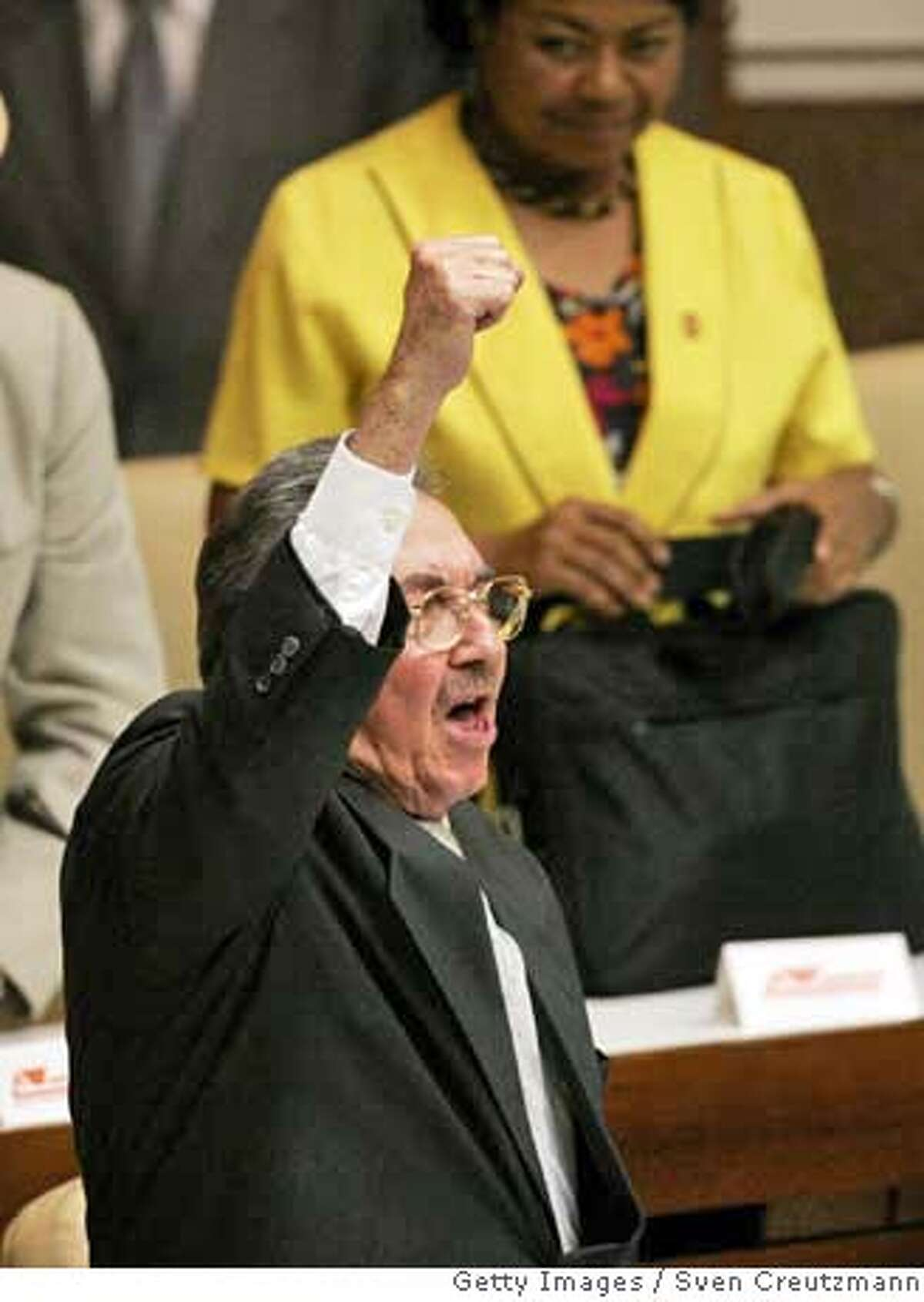 HAVANA - FEBRUARY 24: (AGENTS OUT; MAGAZINES OUT) Raul Castro, after having been elected President of Cuba and succeeding his brother Fidel Castro, raises his arm and clenches his fist as he shouts
