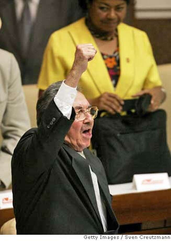 "HAVANA - FEBRUARY 24: (AGENTS OUT; MAGAZINES OUT) Raul Castro, after having been elected President of Cuba and succeeding his brother Fidel Castro, raises his arm and clenches his fist as he shouts ""Viva Fidel"" meaning ""Long live Fidel"" during his first speech during a National Assembly meeting in the Convention Palace February 24, 2008 in Havana, Cuba. Cuba's National Assembly is due to select a new head of state to replace President Fidel Castro, 81-years-old, who is stepping down after nearly half a century in charge. (Photo by Sven Creutzmann/Mambo photo/Getty Images) AGENTS OUT; MAGAZINES OUT Photo: Sven Creutzmann/Mambo Photo"