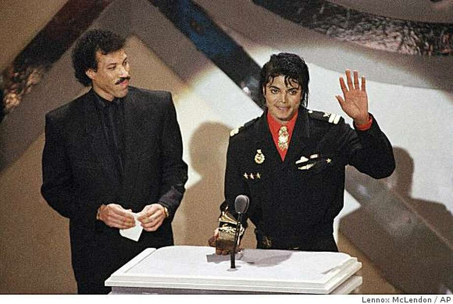 "FILE - In a Tuesday, Feb. 25, 1986 file photo, Michael Jackson and Lionel Richie  receive a Grammy for best song of the year for their song ""We Are the World"" at the 28th annual Grammy Awards in Los Angeles. Richie, a longtime friend to Michael Jackson, says the country is in need of some healing after the pop star's recent death and the Essence Music Festival in New Orleans is going to provide the perfect remedy. Essence, which begins Friday, July 3, 2009 and runs through Sunday, will feature performances by Richie, Beyonce, John Legend, Ne-Yo, Anita Baker and a host of other artists. Organizers are now also planning a special tribute to Jackson. (AP Photo/Lennox McLendon, File) Photo: Lennox McLendon, AP"