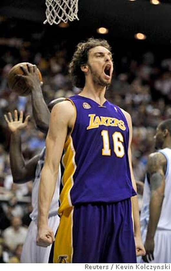 Los Angeles Lakers center Pau Gasol of Spain yells after drawing a foul while playing the Orlando Magic during first-half NBA basketball action against the Orlando Magic in Orlando, Florida February 8, 2008. REUTERS/Kevin Kolczynski (UNITED STATES) Photo: KEVIN KOLCZYNSKI