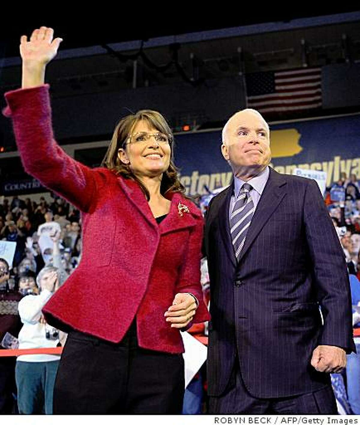 (files) Republican presidential candidate Arizona Sen. John McCain and his vice presidential candidate Alaska Gov. Sarah Palin wave at a campaign rally at Giant Center in Hershey, Pennsylvania on October 28, 2008. US media is reporting July 3, 2009 that Palin has announced her resignation as Alaska governor, and that she will not seek a second term. FILES/AFP PHOTO/Robyn BECK (Photo credit should read ROBYN BECK/AFP/Getty Images)