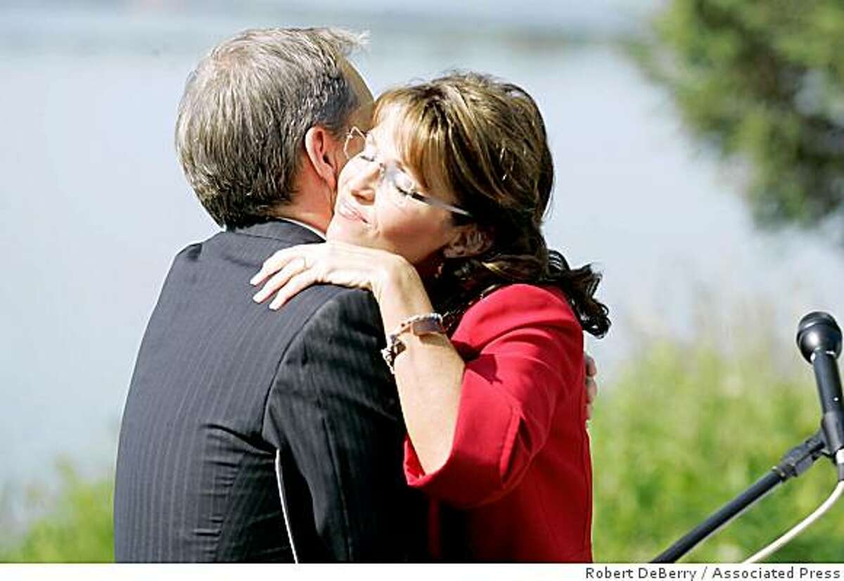 Alaska Gov. Sarah Palin hugs Alaska Lt. Gov. Sean Parnell after she announced she would be stepping down as Governor in Wasilla, Alaska on Friday July 3, 2009. The former Republican vice presidential candidate made the surprise announcement, saying she would step down July 26 but didn't announce her plans.