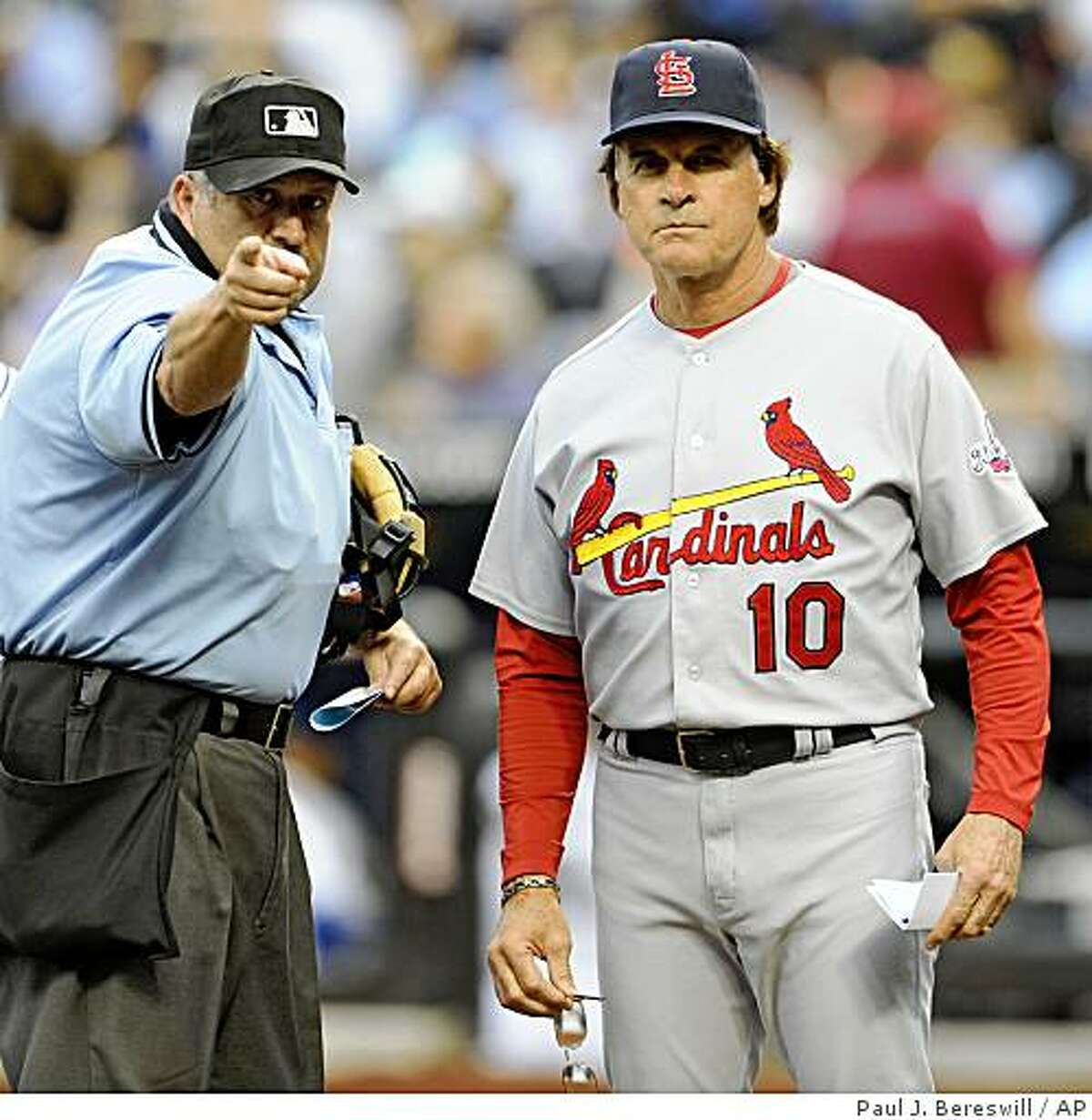 Umpire Dale Scott goes over the ground rules of Citi Field with St. Louis Cardinals manager Tony La Russa before the Cardinals' baseball game against the New York Mets at Citi Field in New York, Monday, June 22, 2009. (AP Photo/Paul J. Bereswill)