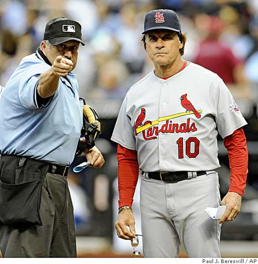 Umpire Dale Scott goes over the ground rules of Citi Field with St. Louis Cardinals manager Tony La Russa before the Cardinals' baseball game against the New York Mets at Citi Field in New York, Monday, June 22, 2009. (AP Photo/Paul J. Bereswill) Photo: Paul J. Bereswill, AP