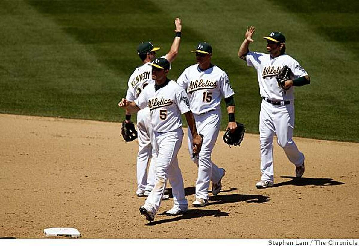 From left, Matt Holliday (5), Adam Kennedy (29), Ryan Sweeney (15), and Travis Buck (6) reacts after beating the Detroit Tigers 5-1 at the Oakland-Alameda County Coliseum in Oakland, Calif on Wednesday, July 1, 2009. The Athletics won 5-1.