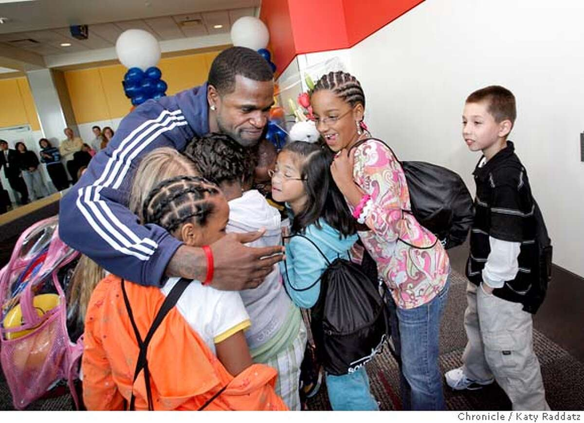 Stephen Jackson of the Golden State Warriors greets third graders from his hometown of Port Arthur, Texas as they exit a Southwest Airlines flight in Oakland, Calif. on Monday, February 25, 2008. The kids won a contest put on by the Warriors, and they will be guests of the Warriors for a game and a tour of the town. Katy Raddatz/THE CHRONICLE