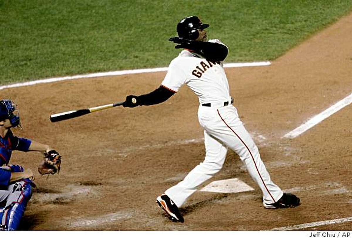 San Francisco Giants' Fred Lewis hits a two-run home run against the Texas Rangers in the sixth inning of a baseball game in San Francisco, Friday, June 19, 2009. (AP Photo/Jeff Chiu)