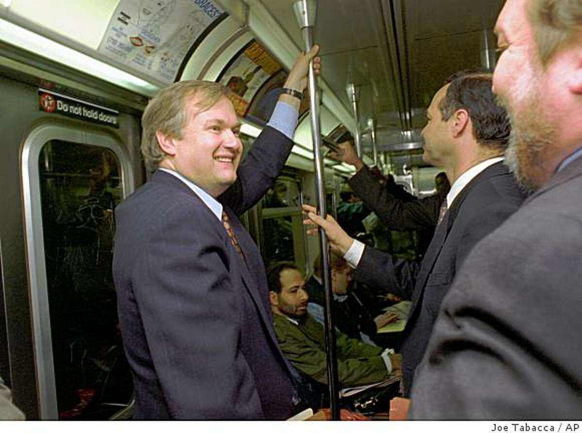 Baseball players union chief Donald Fehr, left, smiles as he rides a subway back to his New York office from federal court Friday, March 31, 1995. Baseball players ended their 232-day strike today when a federal judge ruled against the owners. Exactly when they would return, however, was still uncertain. (AP Photo/Joe Tabacca)