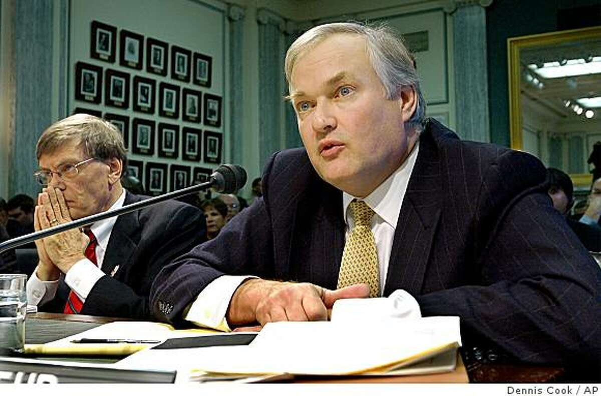 Donald Fehr, right, executive director of the Major League Baseball Players Association, testifies on professional sports drug testing policies before the Senate Commerce, Science and Transportation Committee on Capitol Hill Wednesday, March 10, 2004. At left is Major League Baseball Commissioner Allan