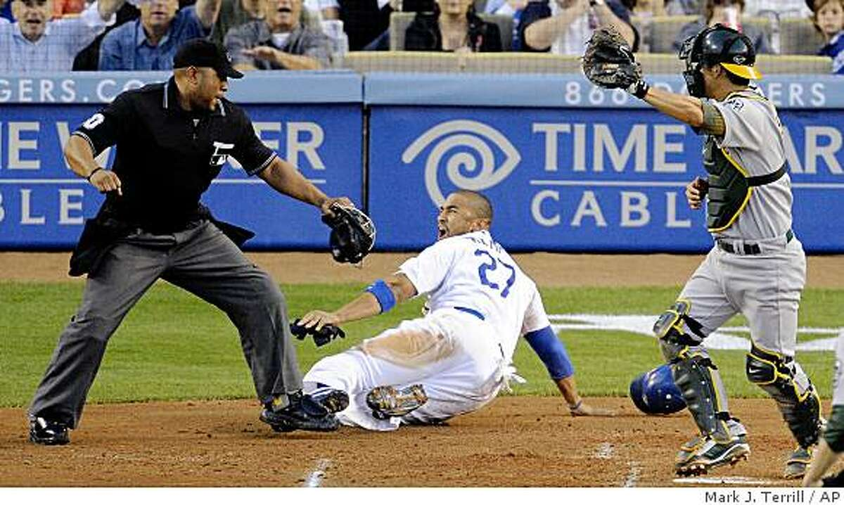 Los Angeles Dodgers' Matt Kemp, center, is called out by home plate umpire Adrian Johnson, left, after he was tagged by Oakland Athletics catcher Kurt Suzuki as he tried to score on a fielder's choice by Hiroki Kuroda during the second inning of a baseball game Wednesday, June 17, 2009, in Los Angeles. (AP Photo/Mark J. Terrill)