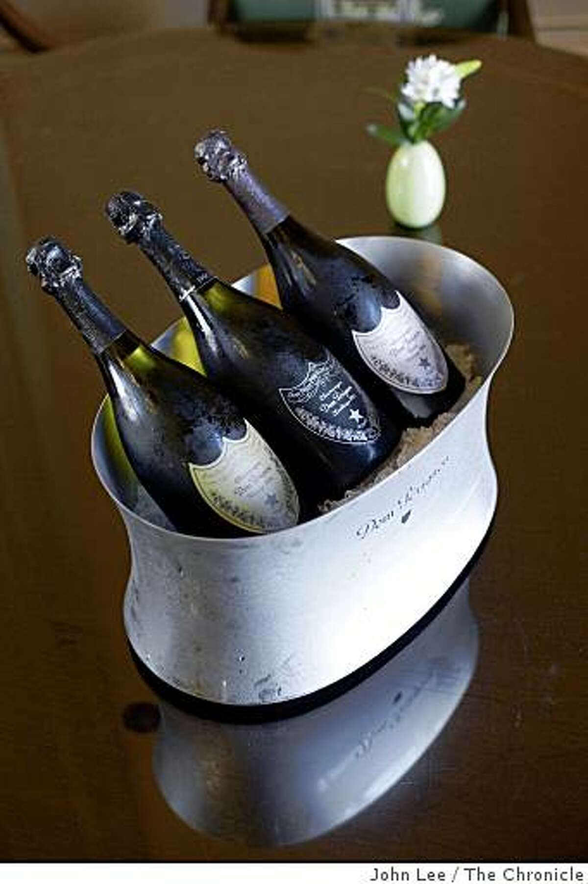 SFISJULY_Spirited_12_JOHNLEEPICTURES.JPG Bottles of Dom Pérignon champagne chilled in an ice bucket inside the Lobby Lounge at the Ritz-Carlton in San Francisco.By JOHN LEE/SPECIAL TO THE CHRONICLE